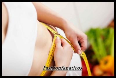 mujer midiendo contorno para adelgazar